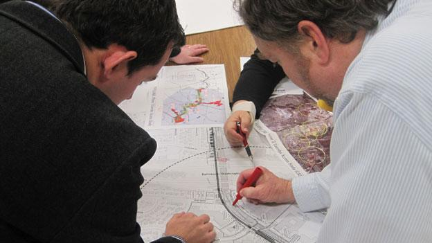 Residents in the Beacon Heights section of Riverdale, Md. examine plans for the proposed Purple Line light rail transit line.