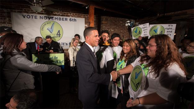 Maryland Lt. Gov. Anthony Brown shaking hands at a Question 4 victory party on Election Night.