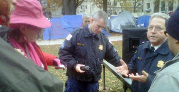 Police speak with Occupy protesters prior to their march on Key Bridge earlier in November.