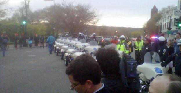 A wall of Metro Police Department motorcycles blocks the route to Key Bridge in advance of the marching Occupy protesters.