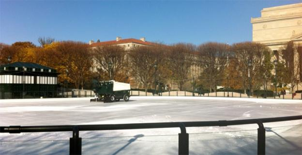 John Connor, manager at the Sculpture Garden ice rink, takes extra time to prepare the ice on Friday morning.