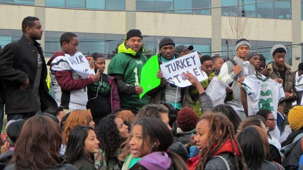 "Students protest outside Woodrow Wilson High School in Northwest D.C. after a ruling this weekend determined that the school cannot play in the annual Thanksgiving Day ""Turkey Bowl"" game."