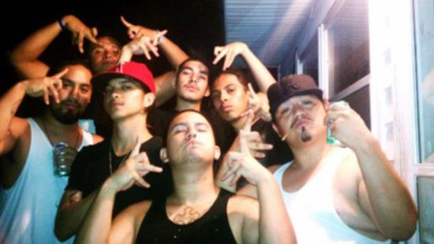 "The ""Lil R"" gang flashes gang signs in this photo supplied by the state attorney's office."