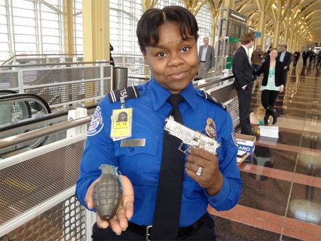 TSA Officer Starr Washington shows off a replica grenade and sequined replica handgun, just two of the many items confiscated at airport security.