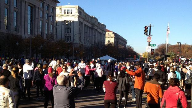 Trot for Hunger racers gather on 13th Street NW before the race.