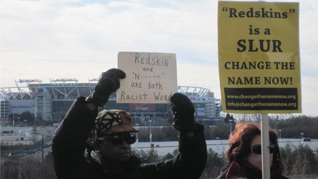 Protesters stand outside FedEx Field during a Redskins game on Nov. 25, 2013, against the San Francisco 49ers.