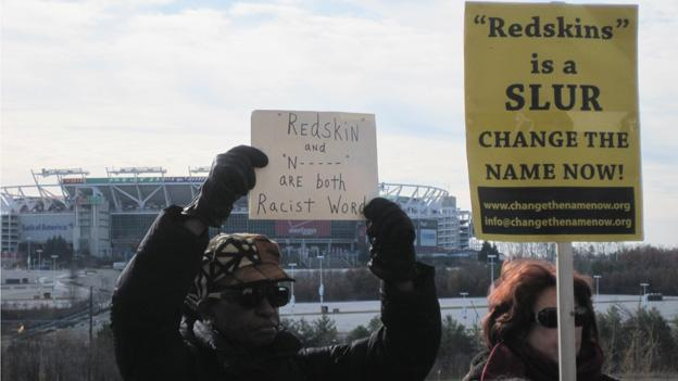 Protesters outside FedEx Field rallied against the Washington Redskins' name on Monday evening.