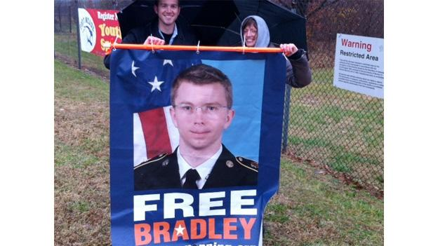 Protesters hold up a sign in support of U.S. Army Private Bradley Manning, who remains in custody for his role in the release of 250,000 diplomatic cables to Wikileaks.
