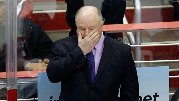 Former Capitals head coach Bruce Boudreau rubs his face after the New York Rangers score a goal on his team in February of 2011. The Capitals announced this morning they would fire the coach, who has been with the team for four seasons.