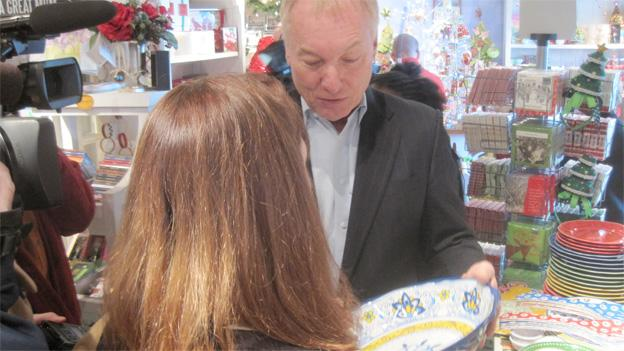 Comptroller Peter Franchot buys a melamine salad bowl in The Blue House in Bethesda, Md., making his pitch for supporting local businesses.