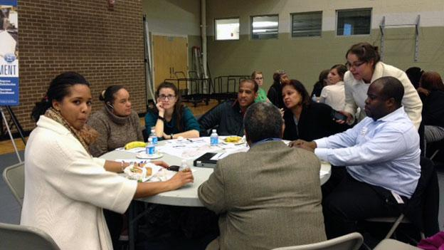 Parents and other residents form Ward 8 gathered Nov. 27 at Savoy Elementary School to weigh in on DCPS' plan to close 20 schools, including four in their ward.
