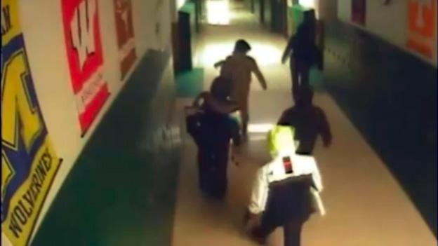 Five individuals stole computers from a Northwest D.C. elementary school on Black Friday and were captured on a video camera.