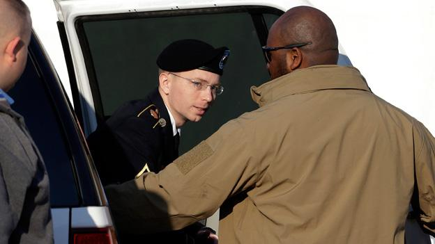 In this June 25, 2012 file photo, Army Pfc. Bradley Manning, right, is escorted out of a courthouse in Fort Meade, Md.