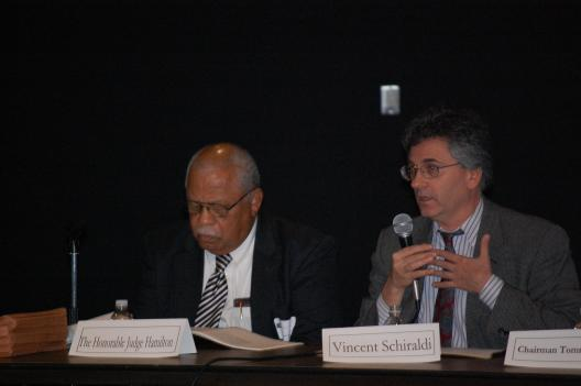 Former Superior Court Judge Eugene Hamilton discusses juvenile justice on a panel with Vincent Schiraldi, the head of D.C.'s Department of Youth Rehabilitative Services.