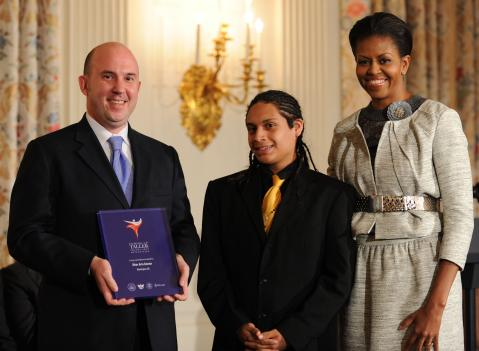 Michelle Obama, presenting the 2009 Coming Up Taller Award at the White House.