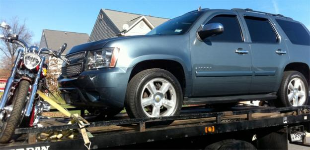 A Chevy Tahoe and Victory motorcycle were towed away from the home of Harry Thomas Jr., Ward 5 councilmember, on Friday.