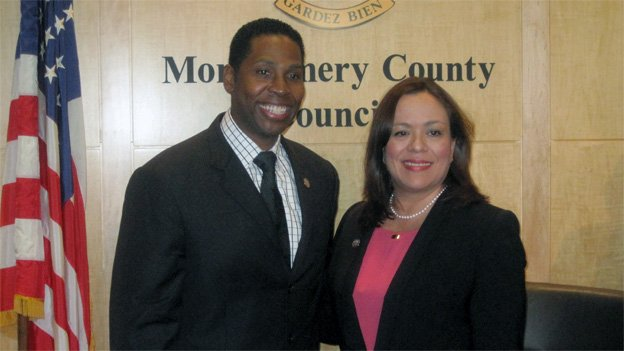 New council president Craig Rice, left, stands next to his predecessor Nancy Navarro.