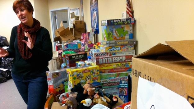 """Cyndi Lucas of """"Operation Homefront"""" displays some of the toys that will be distributed to children of military families."""