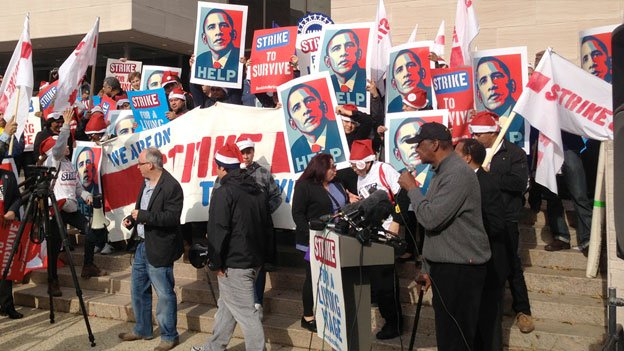 Protesters lined the Air and Space Museum Thursday to call for attention to the federal minimum wage.