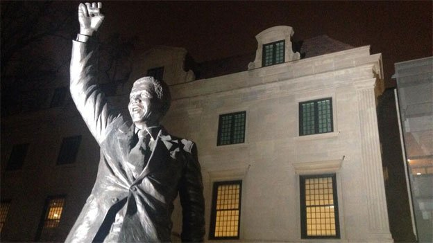 The Nelson Mandela statue in front of the South African embassy on the night of his death.