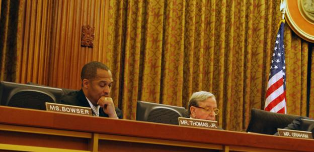 D.C. Council member Harry Thomas Jr., left, was one of the 13 members that unanimously voted in favor of an ethics reform bill Dec. 6. Thomas, who is the subject of an ongoing federal investigation, had little to say during the hearing.