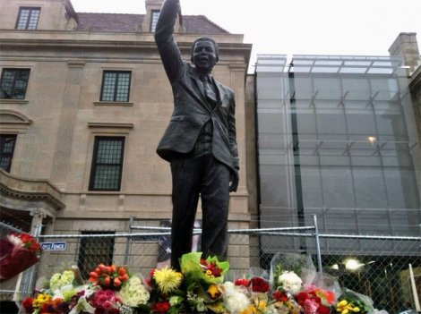 Flowers lie at the feet of the Nelson Mandela statue at the South African embassy.