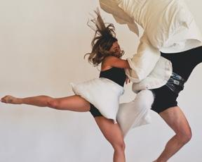 In Collision Course, dancers incorporate the use of pillows to express thoughts, emotions, and vulnerability.