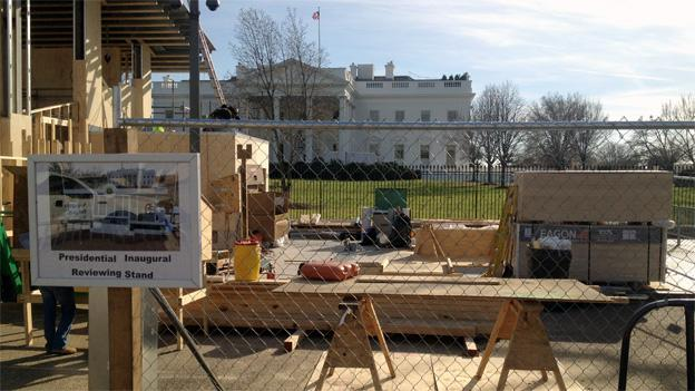 In front of the White House, construction of the reviewing stands for the inauguration is already underway.
