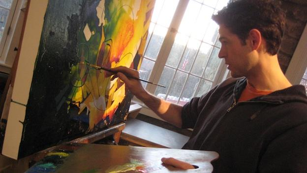 Glen Echo Park resident artist J. Jordan Bruns, a survivor of a rare form of Cushing's Disease, paints in his studio in Glen Echo Park's Stone Tower.