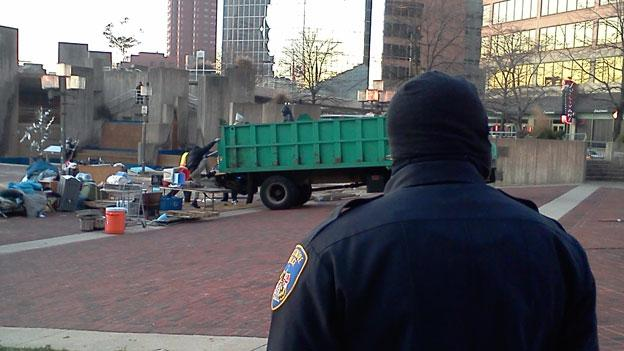 A dump truck clears out what's left of the Occupy Baltimore protest after police cleared out the encampment in the early hours of the morning Dec. 13.