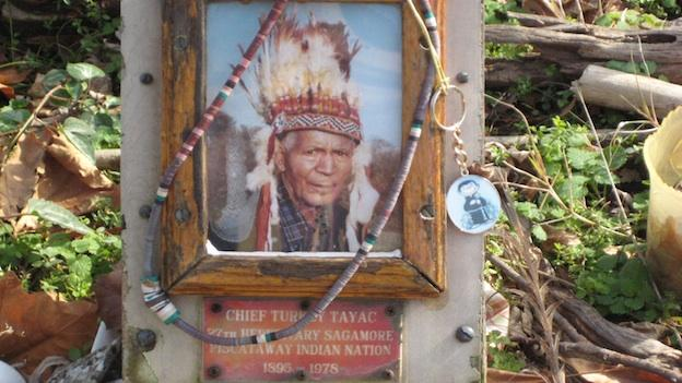 Turkey Tayac's gravesite at Moyaone is marked by a photo of the Piscataway leader and activist; his family changes the photo every year, during the Feast of the Dead.
