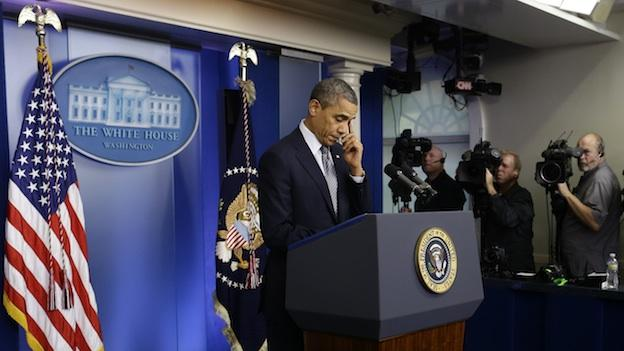 President Barack Obama wipes his eye as he speaks about the school shooting in Newtown, Conn., Friday, Dec. 14, 2012, in the briefing room of the White House in Washington.