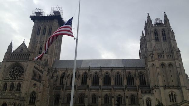 The flag is raised at half-staff at the Washington National Cathedral to honor the victims that died in Newtown, Conn. Friday, Dec. 14, 2012.