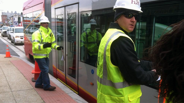 Contractors made sure the streetcar cleared the curb during testing.