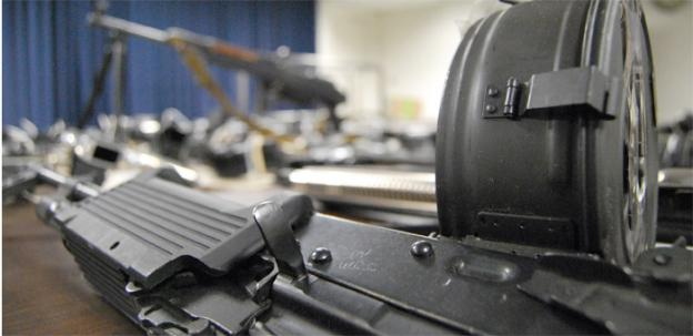 The 160 guns confiscating included an AK-47 rifle with a drum magazine.
