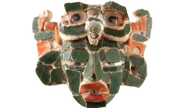 This miniature mosaic of a Mayan noble wearing a sun god headdress is one of the many rare artifacts on view at the Heavenly Jade of the Maya exhibit.