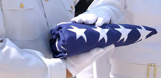 The new law would offer flags to the next of kin of federal employees killed in the line of duty.