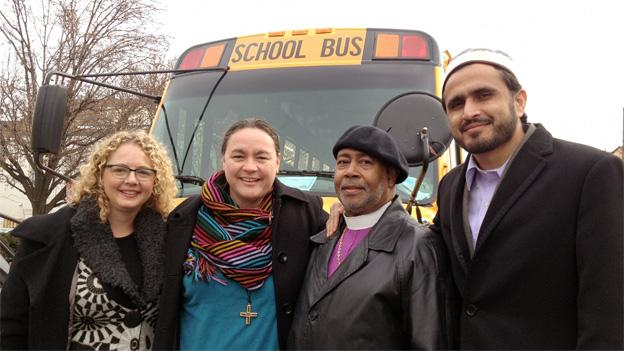 The group of interfaith leaders traveled to the Capitol on a big yellow bus.