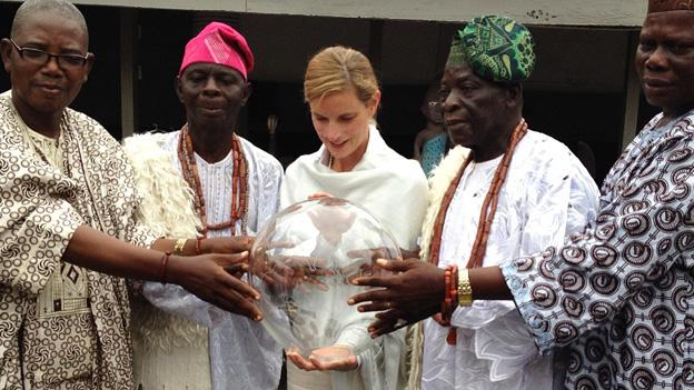 "Shyla Nelson receives blessings from Yoruba elders in the Nigerian city of Abeokuta. Tomorrow Nelson will lead people from all over the world in singing ""Ise Oluwa,"" a Nigerian song of hope and peace, during a synchronized global event."