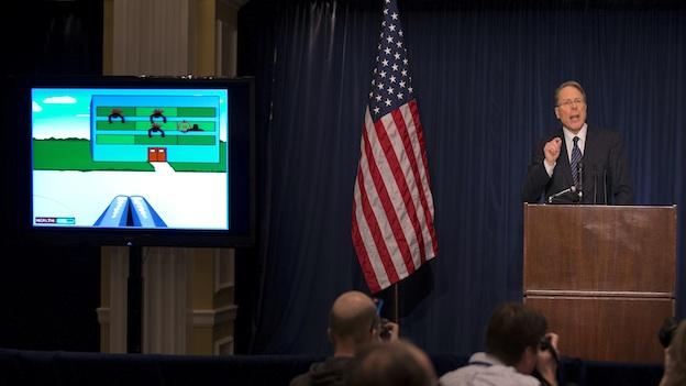 "The National Rifle Association executive vice president Wayne LaPierre gestures as he speaks about the violent online video game ""Kindergarten Killers"", left, during a news conference in response to the Connecticut school shooting on Friday, Dec. 21, 2012 in Washington."