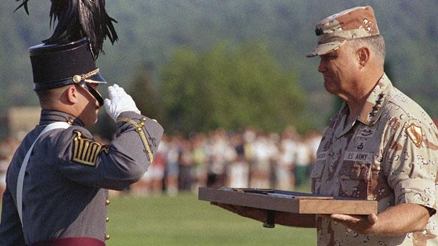 Army Gen. Norman Schwarzkopf, right gets a ceremonial sabre from Cadet First Capt. Douglas P. McCormick of Harrisburgh, Pa., on Wednesday, May 15, 1991 cadet brigade review at the U.S. Military Academy at West Point, NY. Schwarzkopf died Dec. 27.