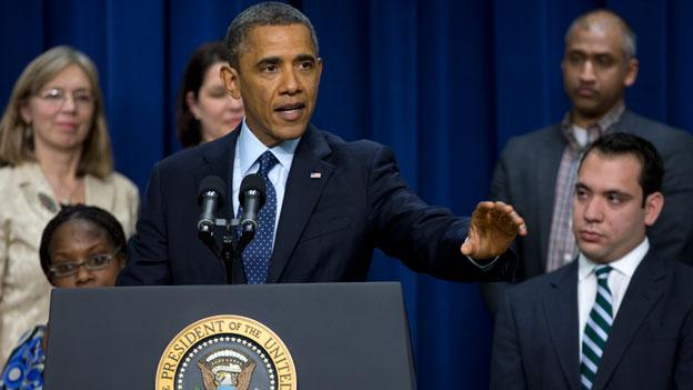 President Barack Obama gestures as he speaks about the fiscal cliff in the South Court Auditorium at the White House.