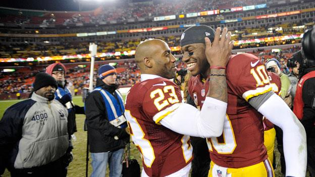 Washington Redskins cornerback DeAngelo Hall (23) celebrates with Washington Redskins quarterback Robert Griffin III (10) after an NFL football game against the Dallas Cowboys Sunday, Dec. 30, 2012, in Landover, Md.