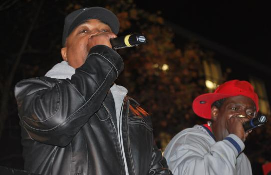 Rappers Chuck D (left) and Flava Flav (right) perform on the back of a flatbed truck in downtown D.C.