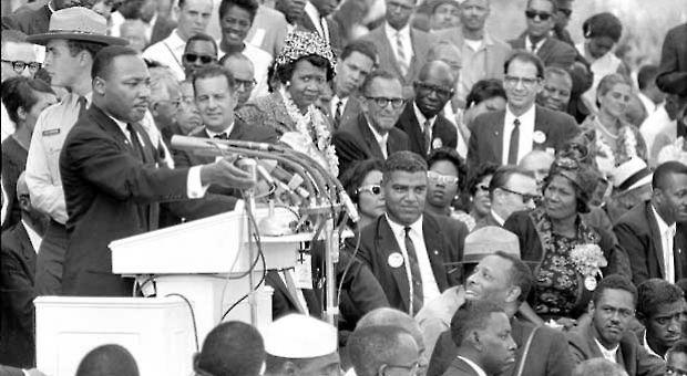 """The Rev. Dr. Martin Luther King Jr., head of the Southern  Christian Leadership Conference, gestures during his """"I Have a Dream""""  speech as he addresses thousands of civil rights supporters gathered in  front of the Lincoln Memorial for the March on Washington for Jobs and  Freedom in Washington, D.C., Aug. 28, 1963. Actor-singer Sammy Davis Jr.  can be seen at extreme right, bottom."""