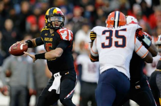 In this Nov. 9, 2013 file photo, Maryland quarterback C.J. Brown, left, throws to a receiver as he is pressured by Syracuse linebacker Dyshawn Davis during an NCAA college football game in College Park, Md. Maryland won't have to cross the state line for its first bowl appearance since 2010. The Terrapins will face Marshall in the Military Bowl on Dec. 27. The game will be held at the home stadium of the Naval Academy, which is around 28 miles from the Maryland campus.