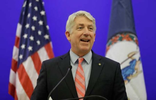 Virginia Attorney General-elect Mark Herring smiles during a news conference at the Capitol in Richmond, Va., Wednesday, Dec. 18, 2013. Herring won the Attorney General race against republican Senator Mark Obenshain.