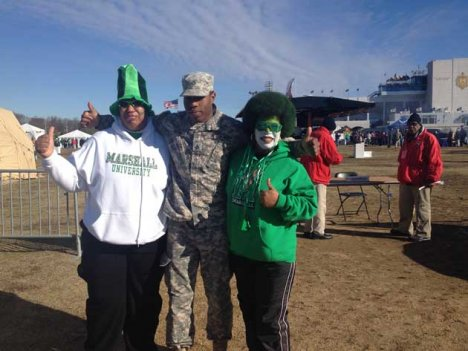 Fans wear Marshall University school colors to the Military Bowl at Navy-Marine Corps Memorial Stadium, Annapolis, Md., on Dec. 27.
