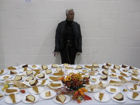 A staff member of the Alfred D. Noyes Children's Center, a state-run youth detention facility in Rockville, Maryland, stands watch over the 'dessert' table during a Thanksgiving meal presided by Lieutenant Governor Anthony Brown.