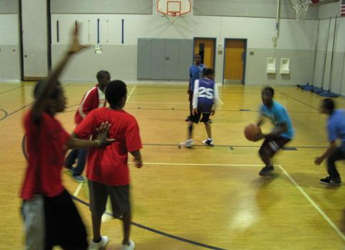 Students at Walt Whitman Middle School in Fairfax County, Va. play basketball in the gymnasium. The school is encouraging the students to be active for at least 60 minutes per day.